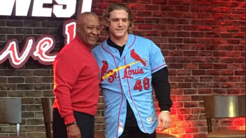 Outfielder Harrison Bader shows off the Cardinals' new powder blue alternate road jersey alongside Hall of Famer Ozzie Smith, who wore a similar jersey when he played, at an event at Ballpark Village on Nov. 19, 2018.