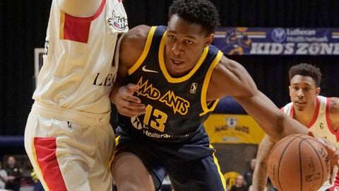 FORT WAYNE, IN - NOVEMBER 9:  Ike Anigbogu #13 of the Fort Wayne Mad Ants drives to the basket against the Erie BayHawks on November 9, 2018 at Memorial Coliseum in Fort Wayne, Indiana. NOTE TO USER: User expressly acknowledges and agrees that, by downloading and or using this photograph, User is consenting to the terms and conditions of the Getty Images License Agreement. Mandatory Copyright Notice: Copyright 2018 NBAE (Photo by Ron Hoskins/NBAE via Getty Images)