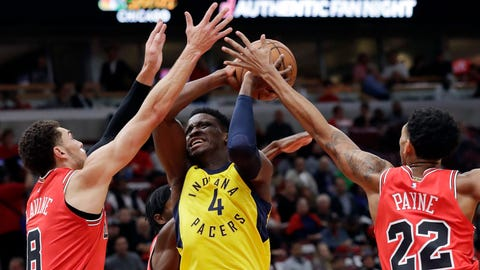 Indiana Pacers guard Victor Oladipo (4) drives to the basket against Chicago Bulls guards Zach LaVine, left, Justin Holiday, back, and Cameron Payne during the first half of an NBA basketball game Friday, Nov. 2, 2018, in Chicago. (AP Photo/Nam Y. Huh)
