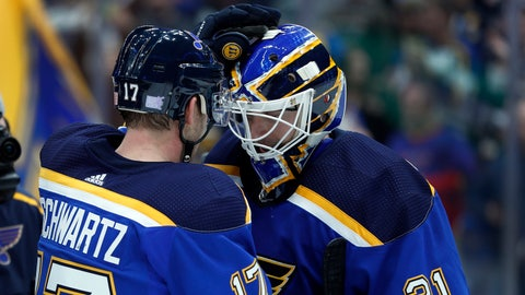 St. Louis Blues goaltender Chad Johnson (31) is congratulated by Jaden Schwartz after getting the shutout in an NHL hockey game against the San Jose Sharks Friday, Nov. 9, 2018, in St. Louis. The Blues won 4-0. (AP Photo/Jeff Roberson)
