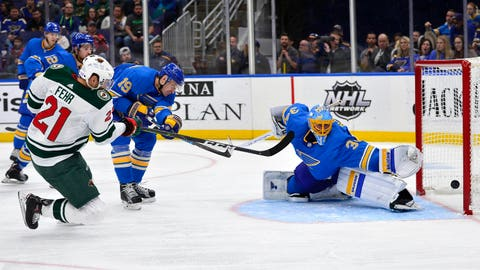Nov 3, 2018; St. Louis, MO, USA; Minnesota Wild center Eric Fehr (21) shoots and scores against St. Louis Blues goaltender Jake Allen (34) during the third period at Enterprise Center. Mandatory Credit: Jeff Curry-USA TODAY Sports