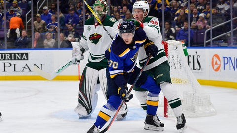 Nov 11, 2018; St. Louis, MO, USA; St. Louis Blues center Oskar Sundqvist (70) skates in front of Minnesota Wild defenseman Nick Seeler (36) and goaltender Devan Dubnyk (40) during the first period at Enterprise Center. Mandatory Credit: Jeff Curry-USA TODAY Sports