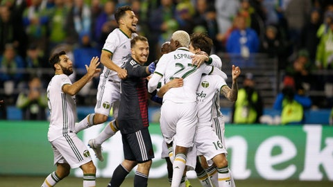 Nov 8, 2018; Seattle, WA, USA; The Portland Timbers celebrate after a win over the Seattle Sounders FC during penalty kicks at CenturyLink Field. Mandatory Credit: Jennifer Buchanan-USA TODAY Sports
