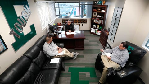 <p>               Eastern Michigan football coach Chris Creighton talks with Dylan Saccade, left, Director of Football Operations and Greg Steiner, right, Associate Athletic Director for Athletic Media Relations about logistics for the teams NCAA football game in the Camellia Bowl in Ypsilanti, Mich., Monday, Dec. 10, 2018. The Eagles will face Georgia Southern in the Camellia Bowl on Saturday, earning a spot in NCAA football postseason play for the second time in three years and just the third time in school history. (AP Photo/Paul Sancya)             </p>