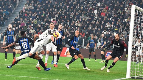 <p>               Juventu's Mario Mandzukic, left, scores his side's opening goal during the Serie A soccer match between Juventus and Inter Milan at the Turin Allianz stadium, Italy, Friday, Dec. 7, 2018. (Andrea Di Marco/ANSA via AP)             </p>