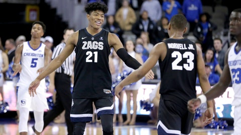 <p>               Creighton's Ty-Shon Alexander (5) walks on the court as Gonzaga's Rui Hachimura (21) celebrates with Zach Norvell Jr. (23) their 103-92 win over Creighton in an NCAA college basketball game in Omaha, Neb., Saturday, Dec. 1, 2018. (AP Photo/Nati Harnik)             </p>