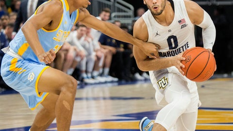 <p>               Marquette guard Markus Howard, right, is guarded by Southern University guard Brendon Brooks, left, during the first half of an NCAA college basketball game Friday, Dec. 28, 2018, in Milwaukee. (AP Photo/Darren Hauck)             </p>