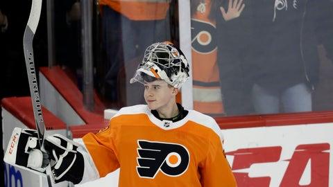 <p>               Philadelphia Flyers' Carter Hart acknowledges the crowd after an NHL hockey game against the Detroit Red Wings, Tuesday, Dec. 18, 2018, in Philadelphia. Philadelphia won 3-2. (AP Photo/Matt Slocum)             </p>