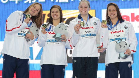 <p>               Gold medalist and world record holder USA's, from left, Olivia Smoliga, Katie Meili, Kelsi Dahlia and Mallory Comerford hold their medals after winning the women's 4x50m medley relay during ceremonies at the 14th FINA World Swimming Championships in Hangzhou, China Wednesday, Dec. 12, 2018. USA broke the record with a time of 1:42.38 (AP Photo/Ng Han Guan)             </p>