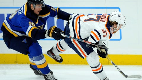 <p>               St. Louis Blues' Jay Bouwmeester (19) reaches for the puck with Edmonton Oilers' Connor McDavid (97) during the second period of an NHL hockey game, Wednesday, Dec. 5, 2018, in St. Louis. (AP Photo/Bill Boyce)             </p>