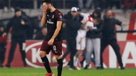 <p>               AC Milan's Hakan Calhanoglu leaves the pitch at the end a Group F Europa League soccer match between Olympiakos and AC Milan at Georgios Karaiskakis stadium in the port of Piraeus, near Athens, Thursday, Dec. 13, 2018. Olympiakos won 3-1. (AP Photo/Thanassis Stavrakis)             </p>