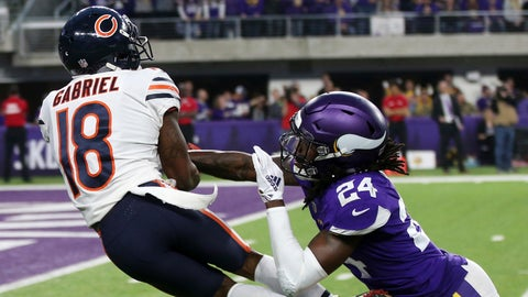 <p>               Chicago Bears wide receiver Taylor Gabriel (18) catches a pass over Minnesota Vikings defensive back Holton Hill (24) during the first half of an NFL football game, Sunday, Dec. 30, 2018, in Minneapolis. (AP Photo/Jim Mone)             </p>