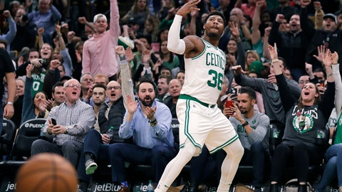 <p>               Boston Celtics guard Marcus Smart (36), and fans, celebrate after hitting a 3-point shot to end the second quarter of a basketball game against the Phoenix Suns in Boston, Wednesday, Dec. 19, 2018. (AP Photo/Charles Krupa)             </p>