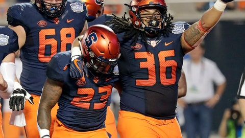 <p>               Syracuse fullback Chris Elmore (36) celebrates with running back Abdul Adams (23) after Adams scored a touchdown on a 3-yard run against West Virginia during the first half of the Camping World Bowl NCAA college football game Friday, Dec. 28, 2018, in Orlando, Fla. (AP Photo/John Raoux)             </p>