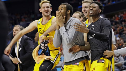 <p>               FILE - In this March 16, 2018, file photo, UMBC players celebrate a teammate's basket during the second half against Virginia i a first-round game in the NCAA men's college basketball tournament in Charlotte, N.C. (AP Photo/Gerry Broome, File)             </p>