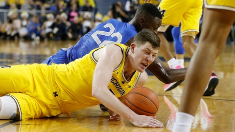 <p>               Air Force Falcons guard Pervis Louder (22) and Michigan Wolverines center Jon Teske (15) chase the loose ball during the first half of an NCAA college basketball game, Saturday, Dec. 22, 2018, in Ann Arbor, Mich. (AP Photo/Carlos Osorio)             </p>