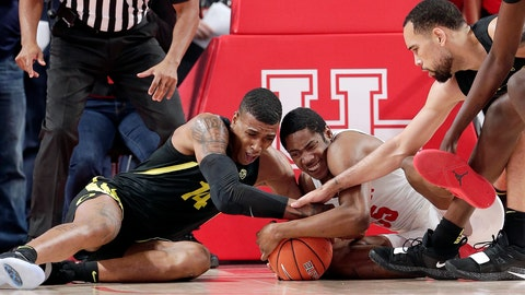 <p>               Oregon forward Kenny Wooten (14) and Houston forward Brison Gresham (55) battle for a loose ball as Paul White, right, reaches in during the first half of an NCAA college basketball game, Saturday, Dec. 1, 2018, in Houston. (AP Photo/Michael Wyke)             </p>