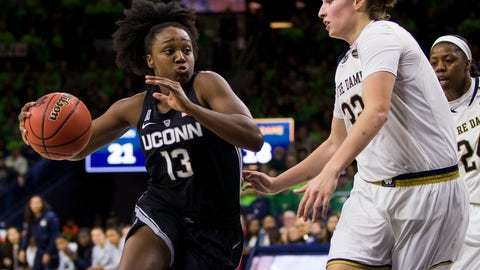 <p>               Connecticut's Christyn Williams (13) drives in next to Notre Dame's Jessica Shepard (32) during the first half of an NCAA college basketball game Sunday, Dec. 2, 2018, in South Bend, Ind. (AP Photo/Robert Franklin)             </p>