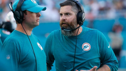 <p>               Miami Dolphins defensive coordinator Matt Burke, left, speaks with head coach Adam Gase, during the second half of an NFL football game against the Buffalo Bills, Sunday, Dec. 2, 2018, in Miami Gardens, Fla. (AP Photo/Joel Auerbach)             </p>