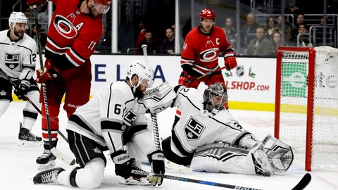<p>               Los Angeles Kings goaltender Jonathan Quick blocks shot by Carolina Hurricanes center Jordan Staal as defenseman Jake Muzzin looks on during the third period of an NHL hockey game in Los Angeles, Sunday, Dec. 2, 2018. The Kings won 2-0. (AP Photo/Chris Carlson)             </p>
