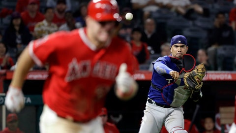 <p>               FILE - In this Sept. 10, 2018, file photo, Texas Rangers catcher Robinson Chirinos, right, throws out Los Angeles Angels' Mike Trout, left, at first base after a ground ball during the ninth inning of a baseball game in Anaheim, Calif. Chirinos and the Houston Astros have finalized a $5.75 million, one-year contract, giving catching-thin Houston another option behind the plate. (AP Photo/Marcio Jose Sanchez, File)             </p>