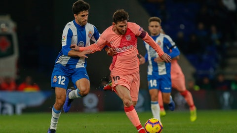 <p>               FC Barcelona's Lionel Messi, center, controls the ball during the Spanish La Liga soccer match between Espanyol and FC Barcelona at RCDE stadium in Cornella Llobregat, Spain, Saturday, Dec. 8, 2018. (AP Photo/Joan Monfort)             </p>