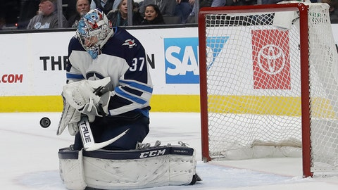 <p>               Winnipeg Jets goalie Connor Hellebuyck stops a San Jose Sharks shot during the first period of an NHL hockey game in San Jose, Calif., Thursday, Dec. 20, 2018. (AP Photo/Jeff Chiu)             </p>