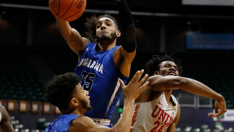 <p>               Indiana State guard Jordan Barnes (2), forward Devin Thomas (35) and UNLV forward Joel Ntambwe (24) fight for a rebound during the first half of an NCAA college basketball game at the Diamond Head Classic, Sunday, Dec. 23, 2018, in Honolulu. (AP Photo/Marco Garcia)             </p>