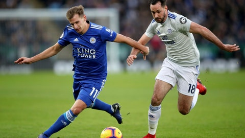 <p>               Leicester City's Marc Albrighton, left, and Cardiff City's Greg Cunningham during their English Premier League soccer match at the King Power Stadium in Leicester, England, Saturday Dec. 29, 2018. (Nick Potts/PA via AP)             </p>