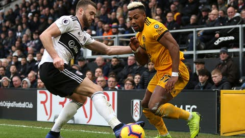 <p>               Fulham's Calum Chambers, left, and Wolverhampton Wanderers' Adama Traore battle for the ball during the English Premier League soccer match at Craven Cottage, London, Wednesday Dec. 26, 2018. (Steven Paston/PA via AP)             </p>