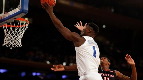 <p>               Duke forward Zion Williamson (1) drives to the basket past Texas Tech forward Tariq Owens (11) during the first half of an NCAA college basketball game Thursday, Dec. 20, 2018, in New York. (AP Photo/Adam Hunger)             </p>