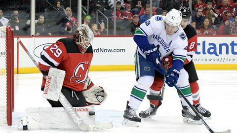 <p>               New Jersey Devils goaltender Mackenzie Blackwood (29) makes a save as New Jersey Devils defenseman Will Butcher (8) checks Vancouver Canucks center Bo Horvat (53) during the first period of an NHL hockey game Monday, Dec. 31, 2018, in Newark, N.J. Blackwood stopped 25 shots as the Devils defeated the Canucks 4-0. (AP Photo/Bill Kostroun)             </p>