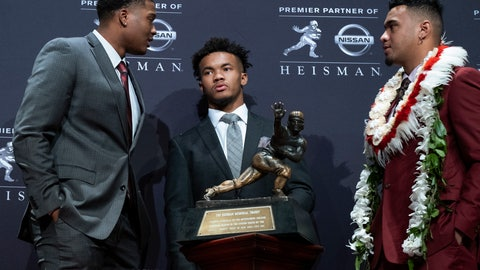 <p>               Heisman Trophy finalists, from left, Dwayne Haskins, from Ohio State; Kyler Murray, from Oklahoma; and Tua Tagovailoa, from Alabama, stand near the trophy during a media event Saturday, Dec. 8, 2018, in New York. (AP Photo/Craig Ruttle)             </p>