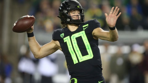 <p>               File-This Nov. 17, 2018, file photo shows Oregon quarterback Justin Herbert throwing down field against Arizona State during the first quarter of an NCAA college football game in Eugene, Ore.  Herbert says he'll return for his senior season. Herbert announced his decision on Wednesday, Dec. 26, 2018, before the Oregon left Eugene for the Redbox Bowl. Oregon plays Michigan State on Monday. (AP Photo/Chris Pietsch, File)             </p>