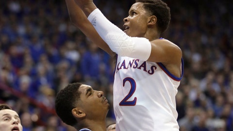 <p>               Kansas guard Charlie Moore, right, shoots over Villanova forward Jermaine Samuels, left, during the first half of an NCAA college basketball game in Lawrence, Kan., Saturday, Dec. 15, 2018. (AP Photo/Orlin Wagner)             </p>