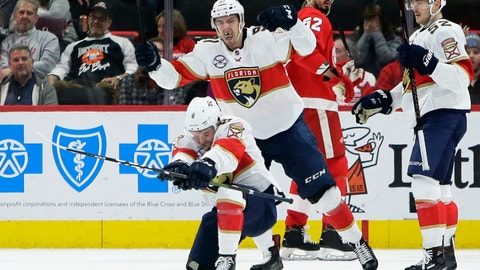 <p>               Florida Panthers center Jayce Hawryluk (8) celebrates with right wing Juho Lammikko (91), of Finland, after scoring against the Detroit Red Wings during the second period of an NHL hockey game Monday, Dec. 31, 2018, in Detroit. (AP Photo/Duane Burleson)             </p>