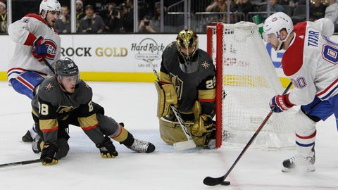 <p>               Vegas Golden Knights defenseman Nate Schmidt (88) and goaltender Marc-Andre Fleury (29) try to hold off pressure from Montreal Canadiens' Tomas Tatar, right, and Phillip Danault, left, during the third period of an NHL hockey game Saturday, Dec. 22, 2018, in Las Vegas. The Canadiens won in overtime, 4-3. (AP Photo/Joe Buglewicz)             </p>