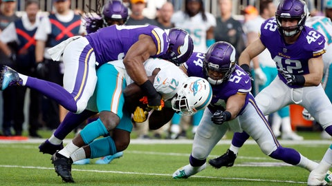 <p>               Miami Dolphins running back Frank Gore (21) is tackled by Minnesota Vikings defensive end Danielle Hunter, left, and middle linebacker Eric Kendricks (54) during the first half of an NFL football game, Sunday, Dec. 16, 2018, in Minneapolis. (AP Photo/Bruce Kluckhohn)             </p>