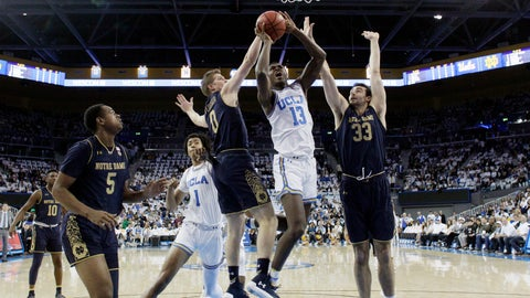 <p>               UCLA guard Kris Wilkes (13) drives to the basket between Notre Dame's Rex Pflueger (0) and John Mooney (33) during the first half of an NCAA college basketball game Saturday, Dec. 8, 2018, in Los Angeles. (AP Photo/Marcio Jose Sanchez)             </p>