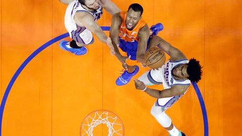<p>               Cleveland Cavaliers' Rodney Hood, center, drives to the basket between Sacramento Kings' Kosta Koufos, left, and Sacramento Kings' Marvin Bagley III in the first half of an NBA basketball game, Friday, Dec. 7, 2018, in Cleveland. (AP Photo/Tony Dejak)             </p>
