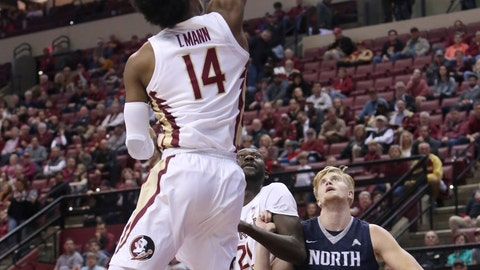 <p>               Florida State's Terance Mann (14) shoots a floater over North Florida's Noah Horchler (0) in the first half of an NCAA college basketball game, Wednesday, Dec. 19, 2018, in Tallahassee, Fla. Florida State won 95-81. (AP Photo/Steve Cannon)             </p>