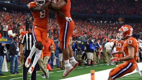 <p>               Clemson wide receiver Justyn Ross (8), defensive lineman Christian Wilkins (42) and wide receiver Hunter Renfrow (13) celebrates touchdown scored by Ross in the first half of the NCAA Cotton Bowl semi-final playoff football game against Notre Dame on Saturday, Dec. 29, 2018, in Arlington, Texas. (AP Photo/Jeffrey McWhorter)             </p>