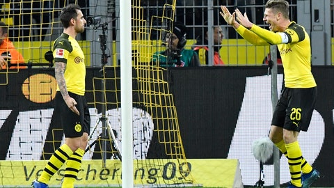 <p>               Dortmund's Paco Alcacer, left, celebrates with Dortmund's Lukasz Piszczek, right, after scoring his side's second goal in the last minute during the German Bundesliga soccer match between Borussia Dortmund and SC Freiburg in Dortmund, Germany, Saturday, Dec. 1, 2018. (AP Photo/Martin Meissner)             </p>