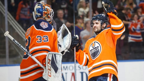 <p>               Edmonton Oilers goaltender Cam Talbot (33) and teammate Kris Russell (4) celebrate the team's win over the Minnesota Wild in an NHL hockey game in Edmonton, Alberta, Friday, Dec. 7, 2018. (Jason Franson/The Canadian Press via AP)             </p>