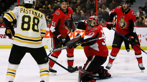 <p>               Boston Bruins right wing David Pastrnak (88) looks on as Ottawa Senators goaltender Mike McKenna (33) makes a blocker save during first-period NHL hockey game action in Ottawa, Ontario, Sunday, Dec. 9, 2018. (Fred Chartrand/The Canadian Press via AP)             </p>