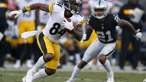 """<p>               File-This Dec. 9, 218, file photo shows Pittsburgh Steelers wide receiver Antonio Brown (84) running against Oakland Raiders cornerback Gareon Conley (21) during the second half of an NFL football game in Oakland, Calif. Brown is modifying his jersey, using a marker to add an """"s"""" to the end of his last name. Safety Sean Davis is mulling a present or two to Cleveland quarterback Baker Mayfield, promising to send the rookie """"a little something something"""" if the Browns can beat the Baltimore Ravens on Sunday and open the door for the Steelers to win a third straight AFC North title.  (AP Photo/D. Ross Cameron, File)             </p>"""