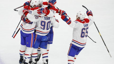 <p>               Montreal Canadiens left wing Tomas Tatar (90) celebrates with teammates after scoring against the Chicago Blackhawks during the third period of an NHL hockey game Sunday, Dec. 9, 2018, in Chicago. (AP Photo/Kamil Krzaczynski)             </p>