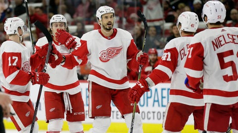 <p>               Detroit Red Wings' Jonathan Ericsson, center facing, of Sweden, celebrates his goal against the Carolina Hurricanes with teammates during the third period of an NHL hockey game in Raleigh, N.C., Thursday, Dec. 20, 2018. Detroit won 4-1. (AP Photo/Gerry Broome)             </p>