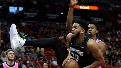 <p>               Minnesota Timberwolves center Karl-Anthony Towns (32) goes to the basket as Miami Heat center Hassan Whiteside, right, defends during the first half of an NBA basketball game, Sunday, Dec. 30, 2018, in Miami. (AP Photo/Lynne Sladky)             </p>