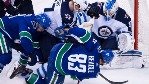 <p>               Winnipeg Jets defenseman Tyler Myers (57) stops Vancouver Canucks center Jay Beagle (83) from getting a shot on Winnipeg Jets goaltender Laurent Brossoit (30) during the second period of an NHL hockey game at Rogers Arena in Vancouver, British Columbia, Saturday, Dec. 22, 2018. (Jonathan Hayward/The Canadian Press via AP)             </p>